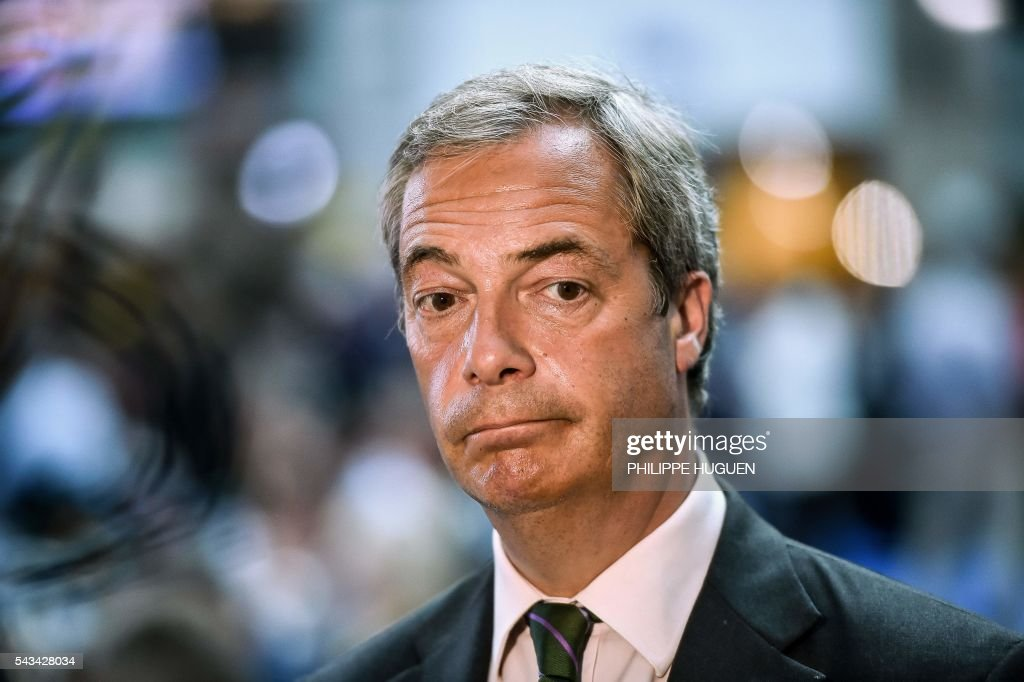 Leader of the United Kingdom Independence Party (UKIP) Nigel Farage looks on during an European Union summit meeting on June 28, 2016 at the EU headquarters in Brussels. Britain's exit from the European Union may erode the bloc's leadership role in fighting climate change and stymie crucial efforts to set more ambitious targets for cutting greenhouse gases, officials and experts said on June 28. European leaders meeting in Brussels pressured British Prime Minister David Cameron Tuesday to launch the two-year withdrawal process 'as soon as possible', but the embattled premier has vowed he will leave that task to a successor to be named on September 9. / AFP / PHILIPPE