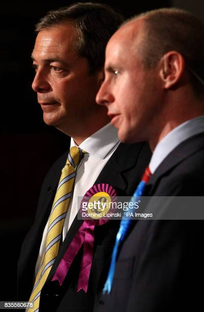Leader of the United Kingdom Independence Party Nigel Farage MEP and Conservative MEP Daniel Hannan speak to television crews following their...