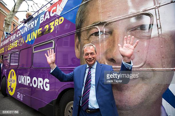Leader of the United Kingdom Independence Party Nigel Farage pictured in front of a campaign bus parked outside Europe House in Westminster on May 20...