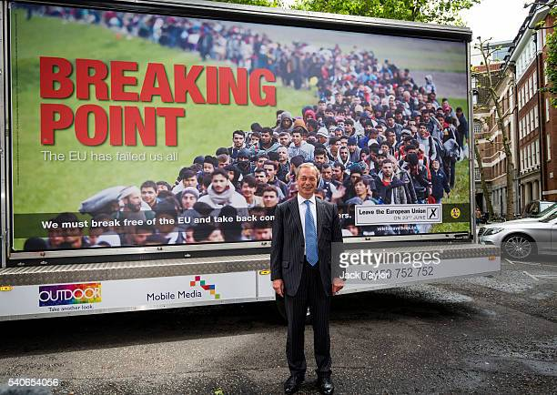 Leader of the United Kingdom Independence Party Nigel Farage poses with the party's new EU referendum poster in Westminster on June 16 2016 in London...