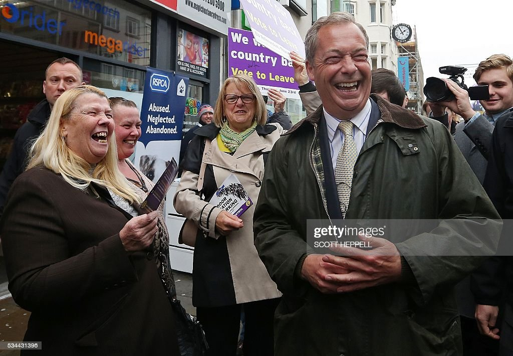 Leader of the United Kingdom Independence Party (UKIP), Nigel Farage (Centre R) reacts as he canvasses for supporters whilst campaigning to leave the European Union, ahead of the June 23 referendum, in Newcastle upon Tyne, north-east England on May 26, 2016. A series of recent polls suggest a widening lead for supporters of Britain's continued European Union membership, handing 'Remain' campaigners a psychological boost, before the country votes in a crucial in-out referendum on June 23. / AFP / SCOTT