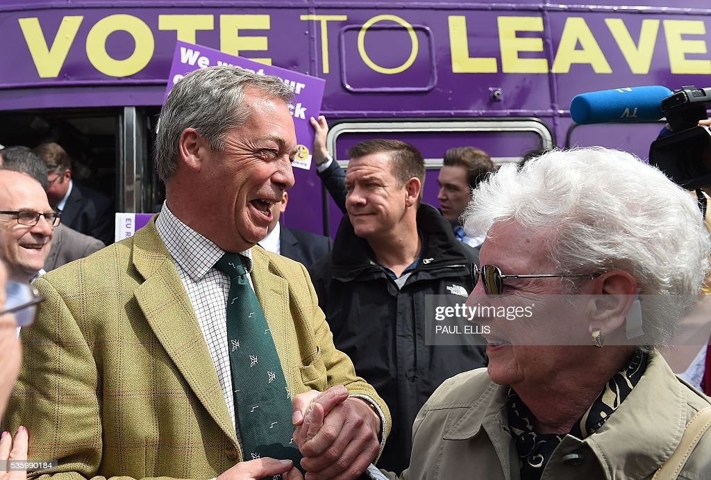 Leader of the United Kingdom Independence Party (UKIP) Nigel Farage (2L) reacts as he campaigns to leave the European Union during a stop on his anti-EU bus tour, in Birmingham, central England, on May 31, 2016, ahead of Britain's forthcoming EU referendum. Politicians and world leaders have dominated the headlines in the campaign for Britain's Jun 23, 2016 EU referendum, but a passionate battle for the country's future is also being fought by activists on the streets. / AFP / PAUL