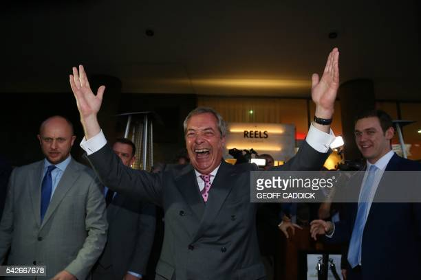 TOPSHOT Leader of the United Kingdom Independence Party Nigel Farage reacts outside the LeaveEU referendum party at Millbank Tower in central London...