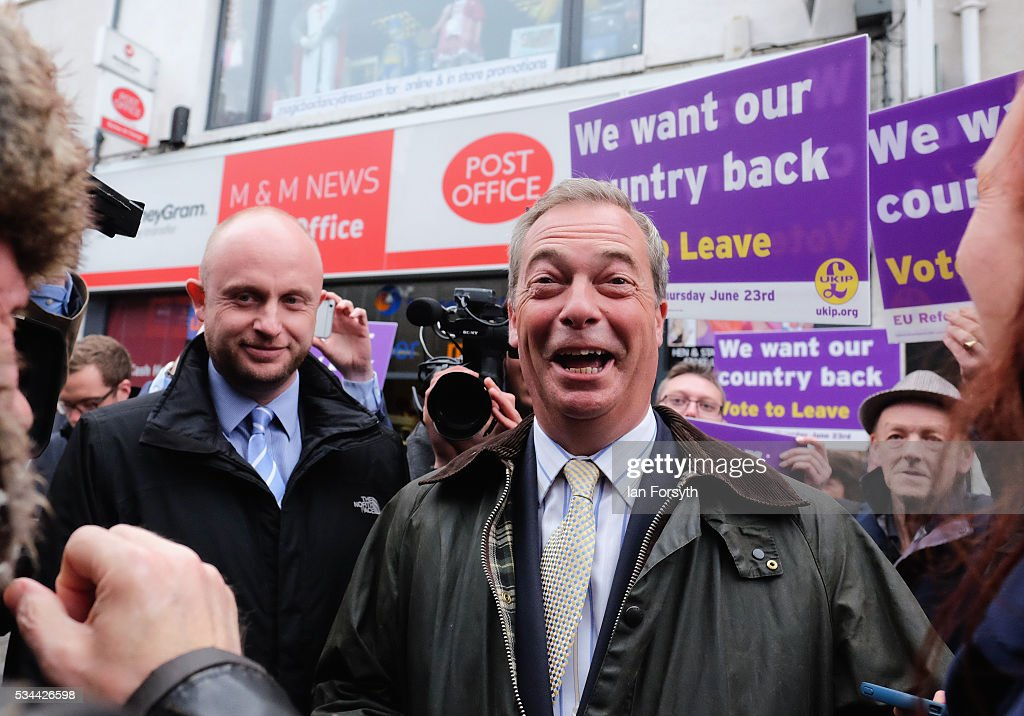 Leader of the United Kingdom Independence Party (UKIP), Nigel Farage shares a joke as he speaks to supporters during a walkabout through Newcastle city centre as he campaigns for votes to leave the European Union on May 26, 2016 in Newcastle Upon Tyne, England. Mr Farage arrived at St Mary's Place in the city to encourage British people to vote to leave the EU in the June 23rd referendum.