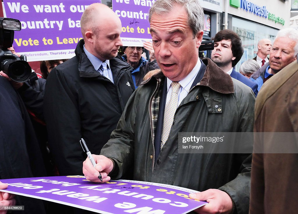Leader of the United Kingdom Independence Party (UKIP), Nigel Farage signs his autograph as he walked through Newcastle city centre as he campaigns for votes to leave the European Union on May 26, 2016 in Newcastle Upon Tyne, England. Mr Farage arrived at St Mary's Place in the city to encourage British people to vote to leave the EU in the June 23rd referendum.