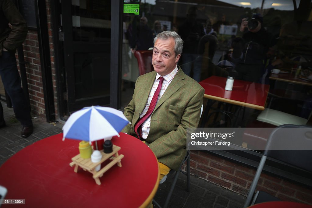 Leader of the United Kingdom Independence Party (UKIP), <a gi-track='captionPersonalityLinkClicked' href=/galleries/search?phrase=Nigel+Farage&family=editorial&specificpeople=697991 ng-click='$event.stopPropagation()'>Nigel Farage</a> sits outside a cafe waiting for his coffee during campaigning for votes to leave the European Union on May 25, 2016 near Sheffield, England. <a gi-track='captionPersonalityLinkClicked' href=/galleries/search?phrase=Nigel+Farage&family=editorial&specificpeople=697991 ng-click='$event.stopPropagation()'>Nigel Farage</a> took his battle bus to Chapeltown, near Sheffield, encouraging British people to vote to leave the EU in the June 23rd referendum.