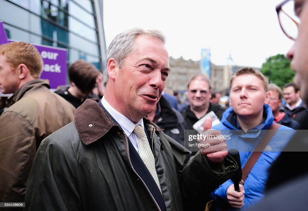 Leader of the United Kingdom Independence Party (UKIP), Nigel Farage speaks to supporters and media on a walkabout through Newcastle city centre as he campaigns for votes to leave the European Union on May 26, 2016 in Newcastle Upon Tyne, England. Mr Farage arrived at St Mary's Place in the city to encourage British people to vote to leave the EU in the June 23rd referendum.