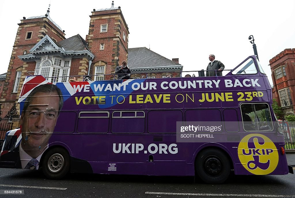 Leader of the United Kingdom Independence Party (UKIP), Nigel Farage (R) stands aboard his party's open-top bus as he arrives to campaign to leave the European Union, ahead of the June 23 referendum, in Newcastle upon Tyne, north-east England on May 26, 2016. A series of recent polls suggest a widening lead for supporters of Britain's continued European Union membership, handing 'Remain' campaigners a psychological boost, before the country votes in a crucial in-out referendum on June 23. / AFP / SCOTT