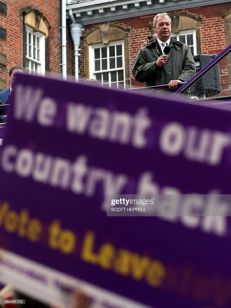 Leader of the United Kingdom Independence Party (UKIP), Nigel Farage stands on board his party's open-top bus as he canvasses for supporters whilst campaigning to leave the European Union, ahead of the June 23 referendum, in Newcastle upon Tyne, north-east England on May 26, 2016. A series of recent polls suggest a widening lead for supporters of Britain's continued European Union membership, handing 'Remain' campaigners a psychological boost, before the country votes in a crucial in-out referendum on June 23. / AFP / SCOTT