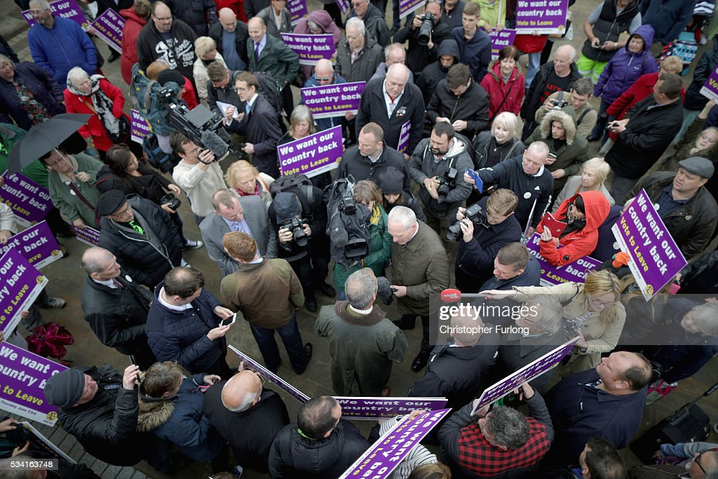 Leader of the United Kingdom Independence Party (UKIP), Nigel Farage talks to supporters and the media as he campaigns for votes to leave the European Union in the referendum on May 25, 2016 in Bolton, England. Nigel Farage took his battle bus to Bolton encouraging British people to vote to leave the EU on 23rd June 2016.
