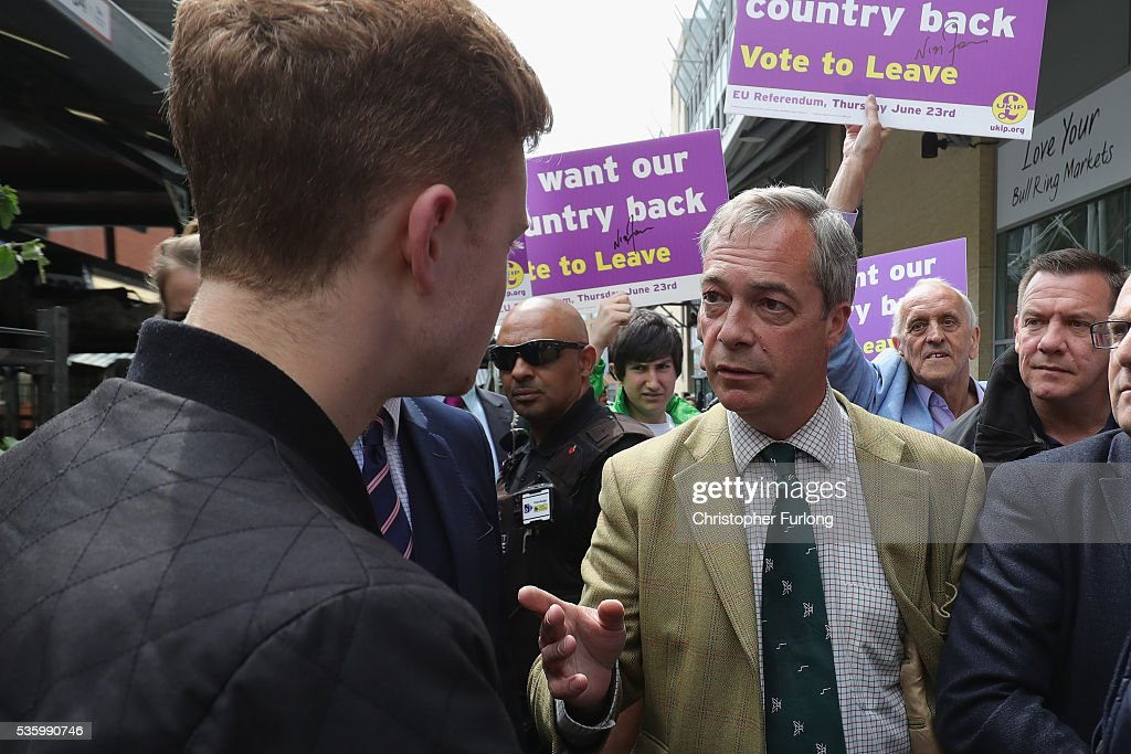 Leader of the United Kingdom Independence Party (UKIP), Nigel Farage talks to EU In supporter Luke Holland (L) as he tours Birmingham Rag Market during campaigning for votes to leave the European Union in the referendum on May 31, 2016 in Birmingham, England. With 23 days to go until the EU referendum, Nigel Farage took his battle bus to Birmingham encouraging British people to vote to leave the EU on 23rd June 2016.
