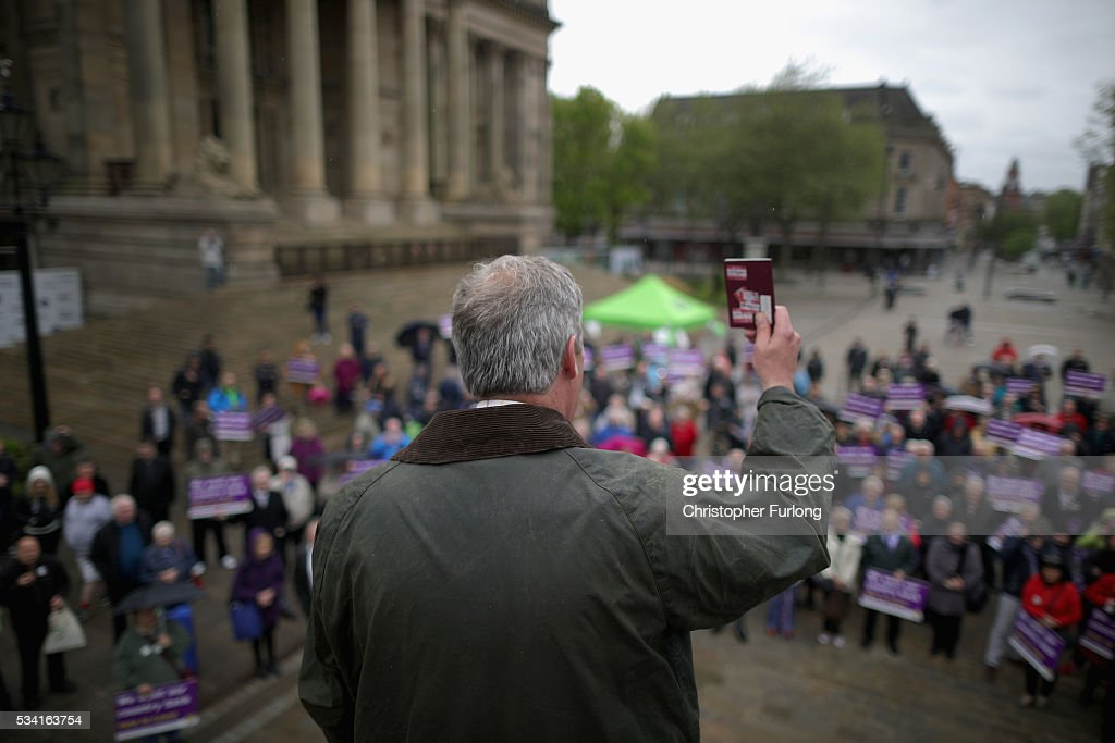 Leader of the United Kingdom Independence Party (UKIP), Nigel Farage waves his passport as he talks to supporters and campaigns for votes to leave the European Union in the referendum on May 25, 2016 in Bolton, England. Nigel Farage took his battle bus to Bolton encouraging British people to vote to leave the EU on 23rd June 2016.
