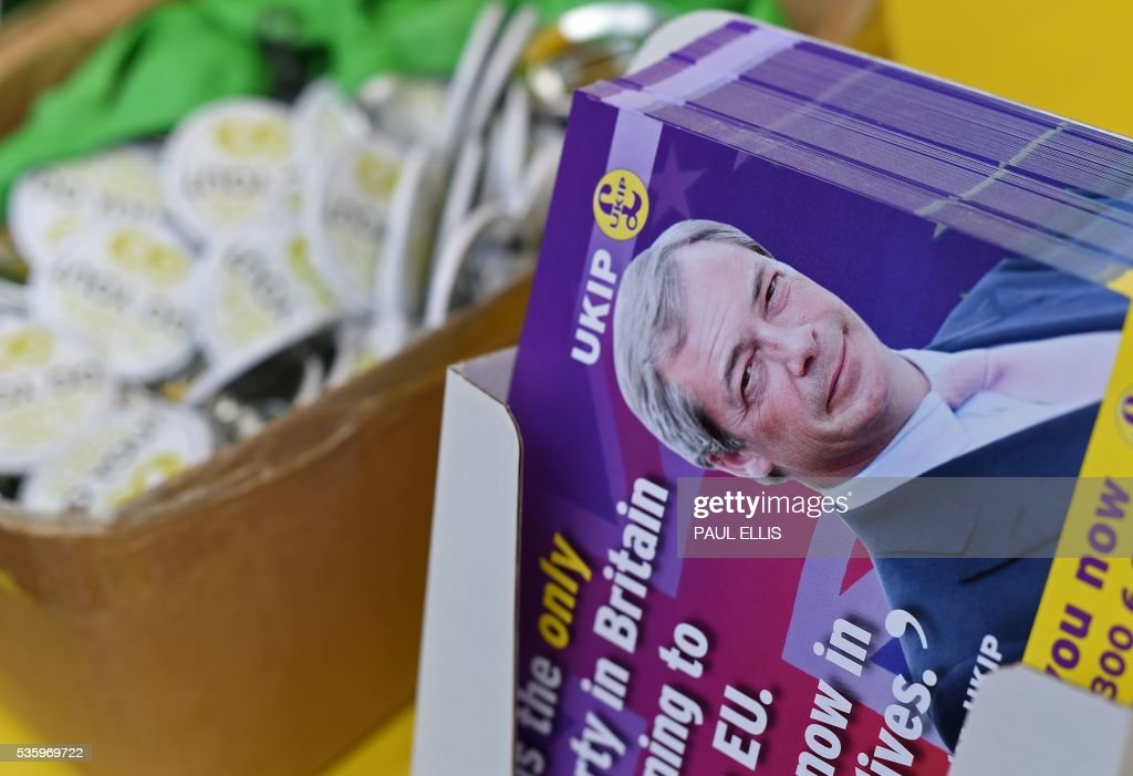 Leader of the United Kingdom Independence Party (UKIP), Nigel Farage's picture is seen on the political party's pro-Brexit campaign leaflets during a campaign event in Birmingham, central England, on May 31, 2016, ahead of the forthcoming referendum. Politicians and world leaders have dominated the headlines in the campaign for Britain's Jun 23, 2016 EU referendum, but a passionate battle for the country's future is also being fought by activists on the streets. / AFP / PAUL