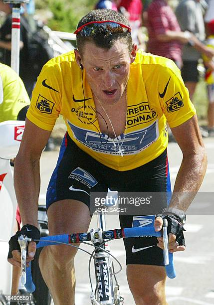 Leader of the US Postal Service team US Lance Armstrong pedals out of the saddle as he suffers in the Mont Ventoux during the 14th stage of the 89th...