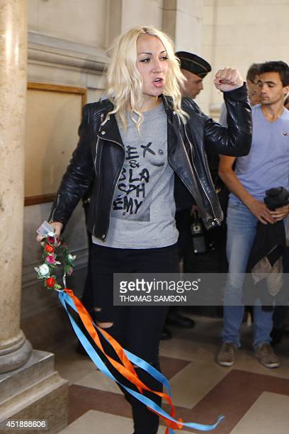 Leader of the women's rights organisation Femen Inna Shevchenko raises her fist as she arrives at the Paris Courthouse to attend the trial of nine...