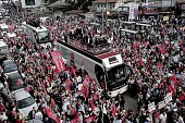Leader of Turkey's main opposition Republican People's Party Kemal Kilicdaroglu greets his supporters from a bus during an election rally in the...