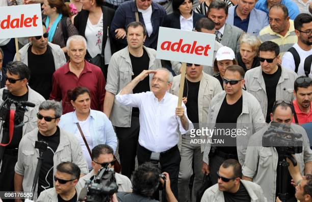 Leader of Turkey's main opposition Republican People's Party Kemal Kilicdaroglu walks with placard reading 'Justice' during a protest march in Ankara...