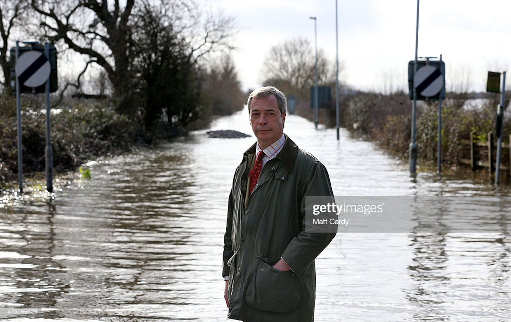 Leader of UKIP Nigel Farage poses for a photograph in front of flood water at Burrowbridge on the Somerset Levels on February 27, 2014 in Somerset, England. According to the Met Office, England and Wales have experienced their wettest winter since records began in 1766, with parts of flood-hit southern England having experienced 83% more rain than average.