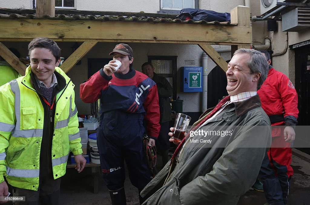 Leader of UKIP Nigel Farage shares a joke with volunteers who have gathered at the King Alfred public house at Burrowbridge on the Somerset Levels on February 27, 2014 in Somerset, England. According to the Met Office, England and Wales have experienced their wettest winter since records began in 1766, with parts of flood-hit southern England having experienced 83% more rain than average.