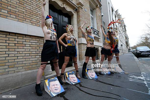 Leader of Ukrainian feminist protest group Femen Inna Shevchenko and activists from the movement demonstrate after pretending to have urinated on...