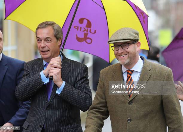 UKIP leader Paul Nuttall and former Leader Nigel Farage MEP laugh off an egg thrown by a youth as they arrive in StokeOnTrent for a public meeting...