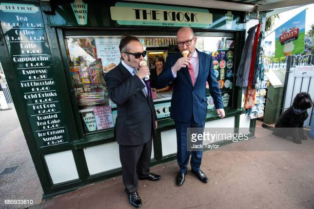 Leader Paul Nuttall and local Parliamentary candidate Paul Oakley eat an ice cream as they campaign on May 20 2017 in ClactononSea England Clacton MP...