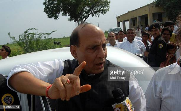 BJP leader Rajnath Singh meets the farmers during a demonstration demanding higher compensation for their land acquired for development of Yamuna...
