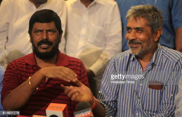 RPI leader Ramdas Athavale and Director Prakash Jha speak with media for his upcoming film Aarkhshan at Novetal Hotel Juhu on Thursday