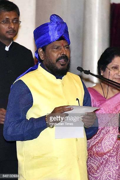 RPI leader Ramdas Athawale takes oath in the presence of President Pranab Mukherjee during the swearingin ceremony of new ministers following Prime...