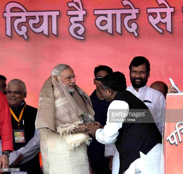 BJP leader Ravi Shankar Prasad greets Prime Minister Narendra Modi during his rally ahead of the upcoming Bihar elections on September 1 2015 in...