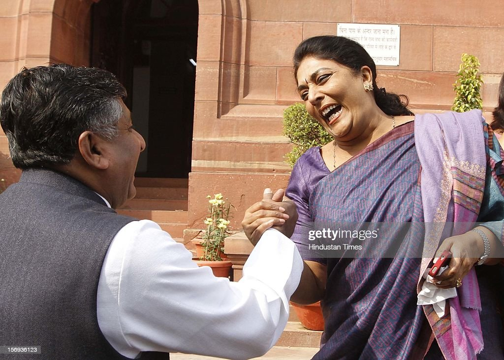 BJP Leader Ravi Shankar Prasad share a light moment with Congress leader Renuka Chowdhary at Parliament House during the winter session, on November 23, 2012 in New Delhi, India.