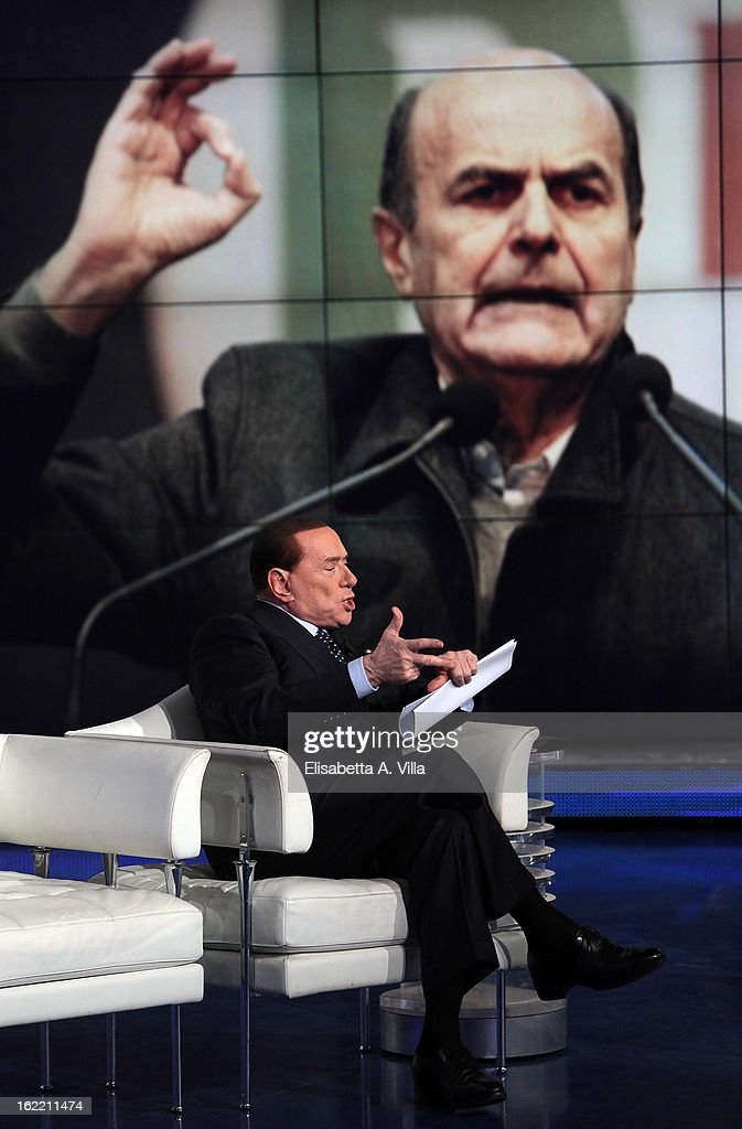 Leader <a gi-track='captionPersonalityLinkClicked' href=/galleries/search?phrase=Silvio+Berlusconi&family=editorial&specificpeople=201842 ng-click='$event.stopPropagation()'>Silvio Berlusconi</a> attends 'Porta A Porta' TV Show while a portrait of Democratic Party (PD) leader Pier Luigi Bersani is displayed on February 20, 2013 in Rome, Italy. The premier candidate Berlusconi continues his campaign for the upcoming general elections that takes place on February 24th and 25th.
