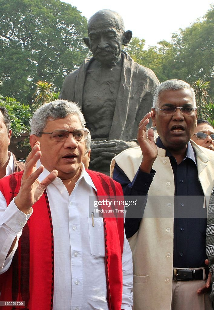 CPIM leader Sitaram Yechri and CPI leader D Raja take part at a demonstration in front of Gandhi statue at Parliament in support of trade unions strike during the opening day of Budget session on February 21, 2013 in New Delhi, India.