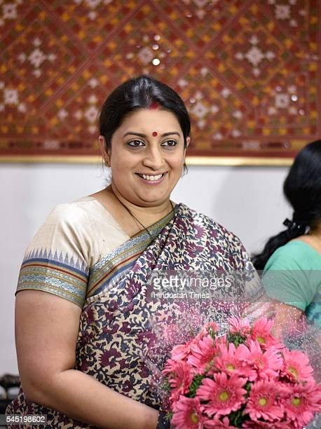 BJP leader Smriti Irani takes charge as Textiles Minister after a massive Cabinet reshuffle on Tuesday at Udyog Bhawan on July 6 2016 in New Delhi...