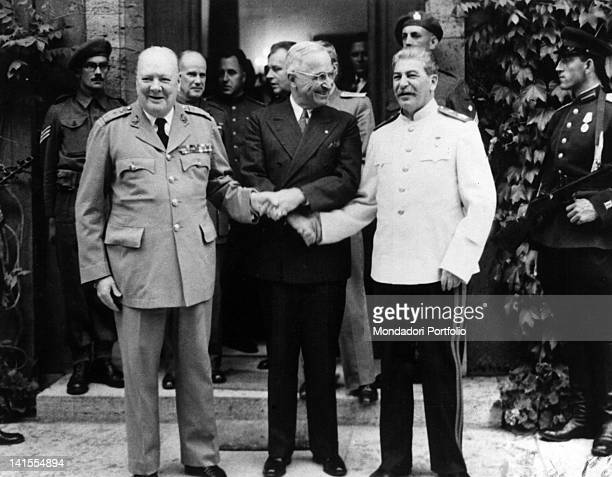 PCUS leader Stalin President of the United States Harry Truman and UK Prime Minister Winston Churchill shaking hands during the Potsdam conference...