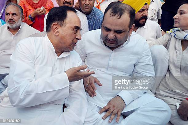 BJP leader Subramanian Swamy meets party MP Mahesh Giri who is staging hunger strike outside the residence of Delhi CM Arvind Kejriwal in New Delhi...
