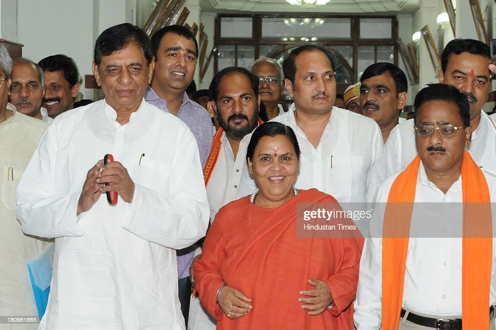 BJP leader Uma Bharati with party MLA Sangeet Som and other MLAs coming together for attending Vidhan Sabha session on September 18, 2013 in Lucknow, India. She warned more tension in Uttar Pradesh if politicians from her party are arrested for instigating the riots that tore through Muzaffarnagar earlier this month, leaving nearly 50 people dead and forcing 40,000 people into refugee camps.