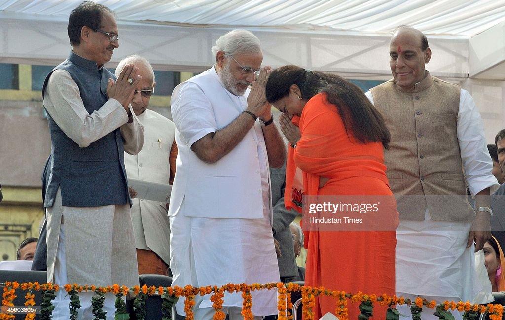 BJP leader Vasundhara Raje greets Madhya Pradesh Chief Minister Shivraj Singh Chouhan BJP Prime Minister candidate Narendra Modi and National...