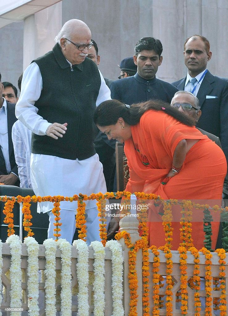 BJP leader Vasundhara Raje seeks blessings from senior BJP leader LK Advani during her swearingin as Rajasthan Chief Minister on December 13 2013 in...