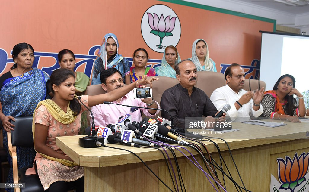 BJP leader Vijender Gupta along with Delhi residents addressing the media persons on the water scarcity at Delhi BJP Office on June 14 2016 in New...