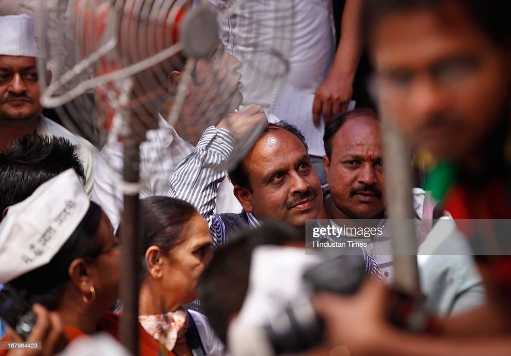 BJP leader Vijender Gupta sitting down after the argument with AAP leader Arvind Kejriwal, during the day long hunger strike by Nirprit Kaur and other women victims of 1984 anti -Sikh riots against acquittal of Sajjan Kumar at Jantar Mantar on May 3, 2013 in New Delhi, India. Sajjan Kumar was acquitted in the case of Anti-sikh riots that broke out 29 years ago on October 31, 1984, after the assassination of then Prime Minister Indira Gandhi.