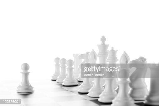 Leader, White Chess Pawns on chess board, black and white