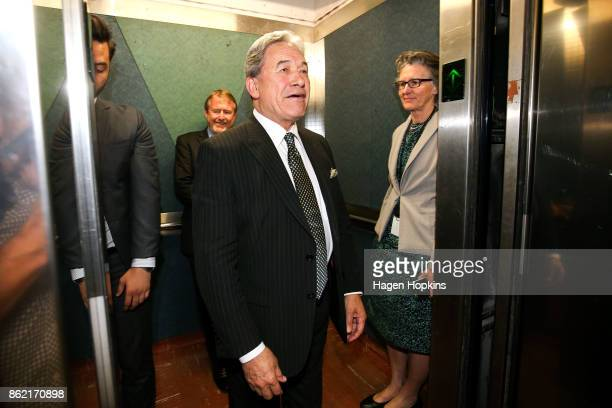 Leader Winston Peters has a final exchange with media before departing while advisor Paul Carrad and press secretary Judith Hughey look on during a...