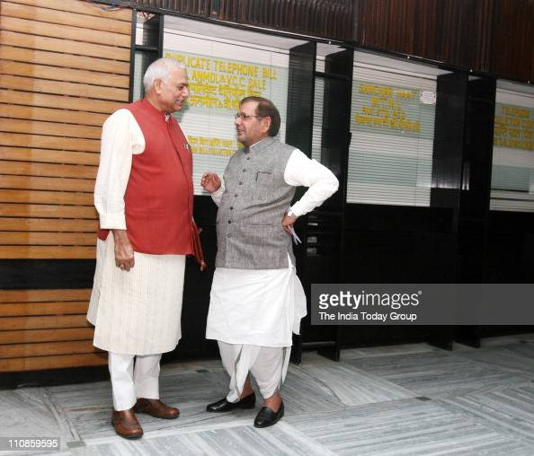 BJP leader Yashwant Sinha and Janata Dal President Sharad Yadav talk to each other after JPC meeting in New Delhi on Thursday March 24 2011