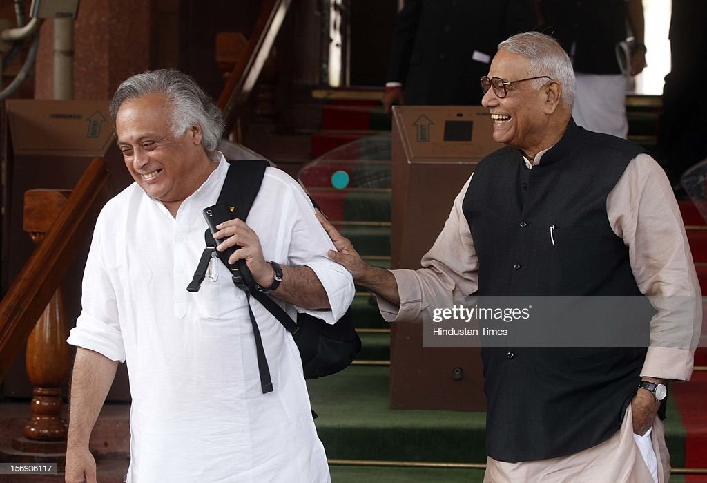 BJP Leader Yashwant Sinha share a light moment with Congress leader Jairam Ramesh at Parliament House during the winter session, on November 23, 2012 in New Delhi, India.