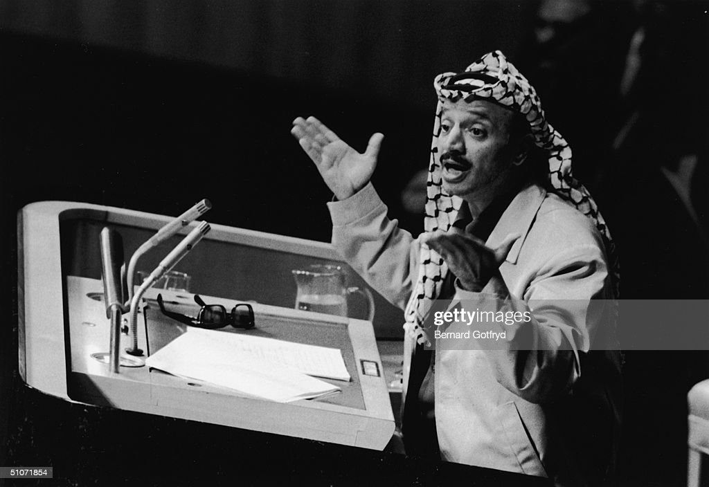 PLO leader Yasser Arafat appears before the United Nations General Assembly on the topic of a Palestinian state New York New York November 13 1974