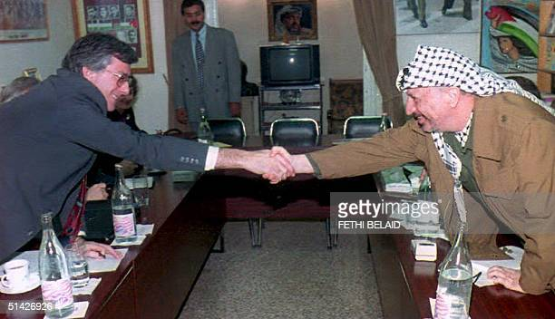 PLO leader Yasser Arafat shakes hand with Dennis Ross US coordinator for the Middle East before their talks 14 March The discussions will try and get...