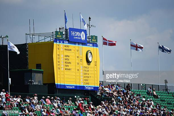 A leaderboard atop a grandstand on the 18th green is seen during the first round of The 143rd Open Championship at Royal Liverpool on July 17 2014 in...