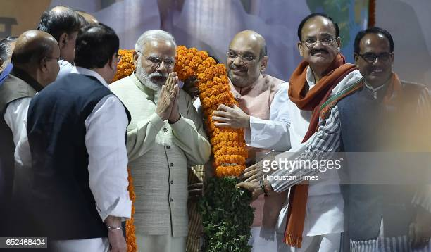 BJP leaders Amit Shah Venkaiah Naidu Shivraj Singh Chouhan and others greets Prime Minister Narendra Modi with a garland during the celebrations at...