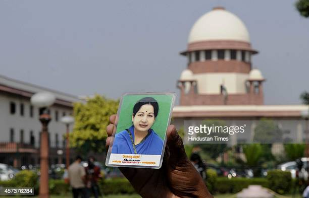 AIADMK leaders and lawyers celebrate after India's Supreme Court has granted bail to the imprisoned former chief minister of the southern state of...